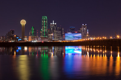 """""""Dallas 2012""""  Dallas, TX The Dallas skyline has changed a lot over the past few years.  The addition of the new Omni hotel has probably had the most dramatic impact upon the skyline.  Every so often we get enough rain around here to flood the Trinity basin.  You then have a very small window of opportunity to grab a shot like this showing the reflection of our amazing skyline. Technical Details: Shot with Canon 5d MK2 and Canon 10-22mm lens.    Panorama created from 5 bracketted horizontal shots."""