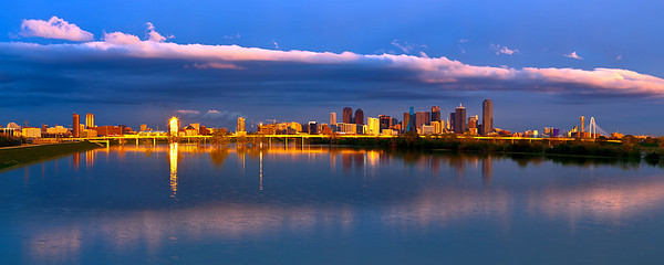 """""""Big D""""  Dallas, TX A late afternoon sunset illuminates the skyline of Dallas Texas as it is reflected in the swollen Trinity River. Technical Details: Shot with Canon 5d MK2 and Canon 24-70mm lens.    Panorama created from 4  horizontall shots."""