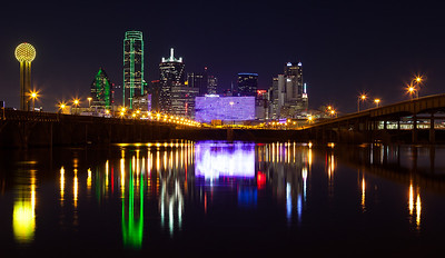 """""""Dallas 2012""""  Dallas, TX The Dallas skyline has changed a lot over the past few years.  The addition of the new Omni hotel has probably had the most dramatic impact upon the skyline.  Every so often we get enough rain around here to flood the Trinity basin.  You then have a very small window of opportunity to grab a shot like this showing the reflection of our amazing skyline. Technical Details: Shot with Canon 5d MK2 and Canon 24-70mm lens."""