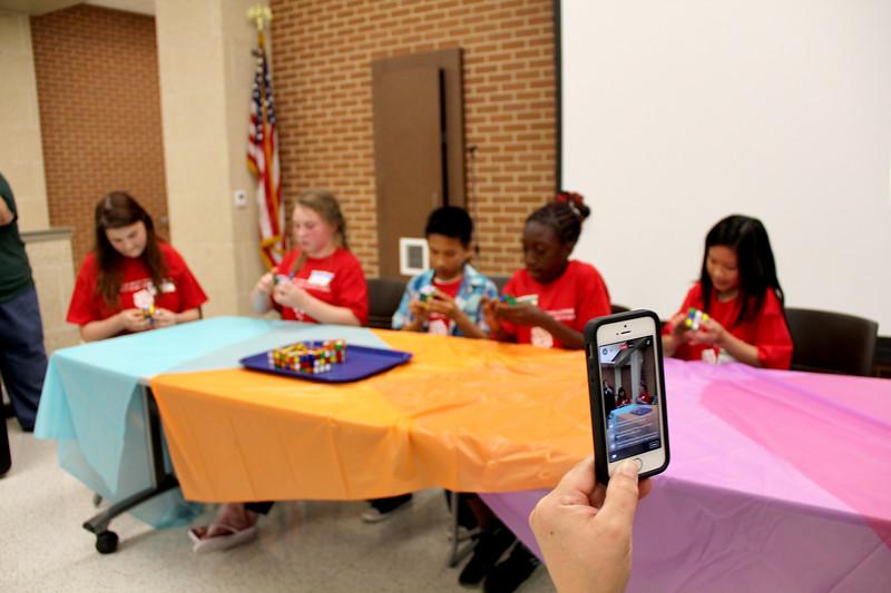 A volunteer streams the contest.