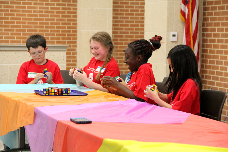 The Red team works on their cubes.