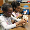 Students focus on gluing their crafts together.