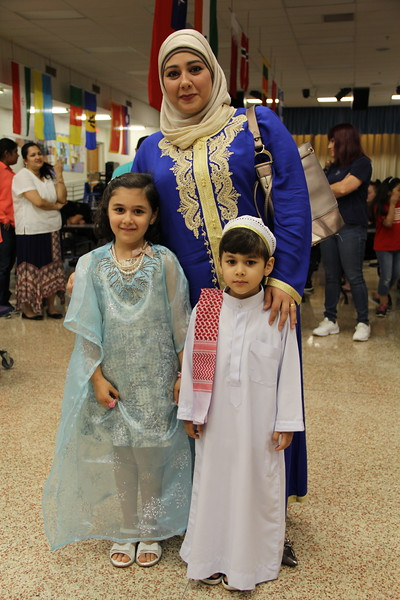 Families dressed in traditional attire.