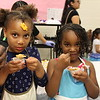 Students eating their food as they look at the camera.
