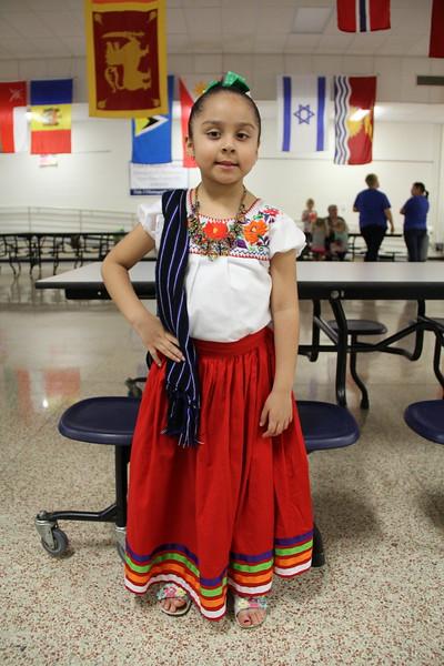 Student poses in cultural attire.