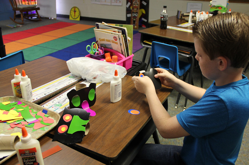 Student focuses on completing craft.
