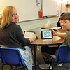 Students play games on their tablets.