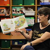Teacher reads story and displays illustrations.