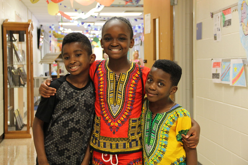 Students pose for a photo in cultural outfits.