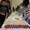 Students get samples of food to try.