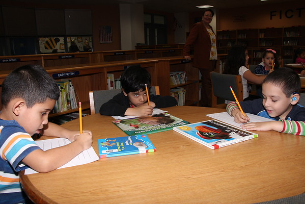 Ms. Lopez class working in the library 2015