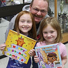Tom Brasfiele took his two daughters, Makenzi and Katelyn to the Crockett bookfair.