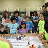 Robotics teams from Harlem and Crockett entertain the audience with demonstrations of what their robots can do.