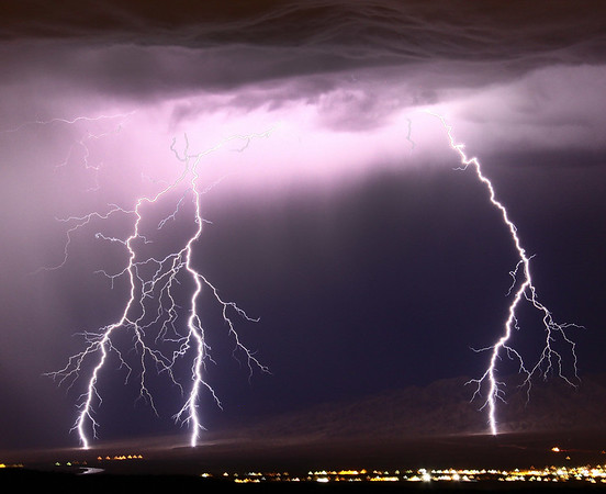 Lightning strikes across the desert skies of Needles California and Laughlin Nevada. Some flash flooding did shut down north bound lanes of highway 95 between Needles and Boulder city as the last day of monsoon storms cross over the high deserts areas. Needles CA. Aug 23, 2009. Photo by Gene Blevins/LA Daily News