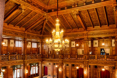 Crystal ceiling chandelier, wood ceiling panels and ornate wood carvings of the ballroom of the Scottish Rite Cathedral, Indianapolis, IIndiana.