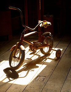 Child bicycle at the former grist mill that is now the Museum of Americana, Adams Mill: Cutler, Indiana.