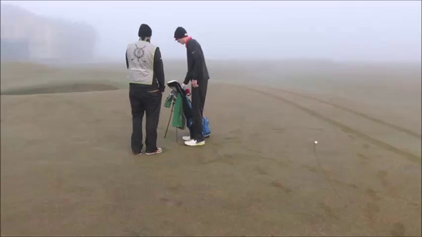 Dexter hits an iron in the thick fog on the Old Course