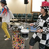 On Tuesday afternoon the Leominster Public Library hosted the music show featuring Elijah T. Grasshopper and Friends. This interactive music concert made kids hop, wiggle and giggle for and hour and was sponsored by Avidia Bank, and Anderson, Bagley &  Mayo Insurance, who are corporate sponsors of the Friends of the Leominster Public Library. Playing the drums during the performance is Angie the Checkerboard Bean. SENTINEL & ENTERPRISE/JOHN LOVE