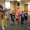 On Tuesday afternoon the Leominster Public Library hosted the music show featuring Elijah T. Grasshopper and Friends. This interactive music concert made kids hop, wiggle and giggle for and hour and was sponsored by Avidia Bank, and Anderson, Bagley &  Mayo Insurance, who are corporate sponsors of the Friends of the Leominster Public Library. Kids help Elijah and The Orange Farmer during one of the songs at the performance. SENTINEL & ENTERPRISE/JOHN LOVE