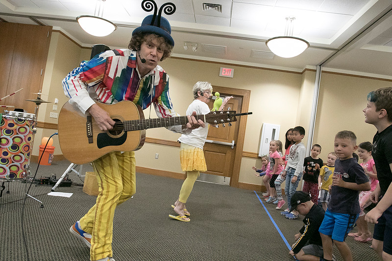 On Tuesday afternoon the Leominster Public Library hosted the music show featuring Elijah T. Grasshopper and Friends. This interactive music concert made kids hop, wiggle and giggle for and hour and was sponsored by Avidia Bank, and Anderson, Bagley &  Mayo Insurance, who are corporate sponsors of the Friends of the Leominster Public Library. Elijah sings to the kids during the performance. SENTINEL & ENTERPRISE/JOHN LOVE