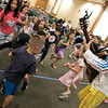 On Tuesday afternoon the Leominster Public Library hosted the music show featuring Elijah T. Grasshopper and Friends. This interactive music concert made kids hop, wiggle and giggle for and hour and was sponsored by Avidia Bank, and Anderson, Bagley &  Mayo Insurance, who are corporate sponsors of the Friends of the Leominster Public Library. Kids dance around as Elijah plays the guitar and sings during the performance. SENTINEL & ENTERPRISE/JOHN LOVE