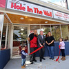 Justine Achin and fiance Eliu Olmo of Lowell open a restaurant, Eliu's Hole in the Wall, in the former Quality Doughnuts building at 398 Fletcher Street. Eliu Olmo and Justine Achin, with son Mateo Olmo, 2, and daughter Gabriella  Olmo, 6, holding the ribbon, hold a ribbon-cutting with Lowell mayor Edward Kennedy. (SUN/Julia Malakie)
