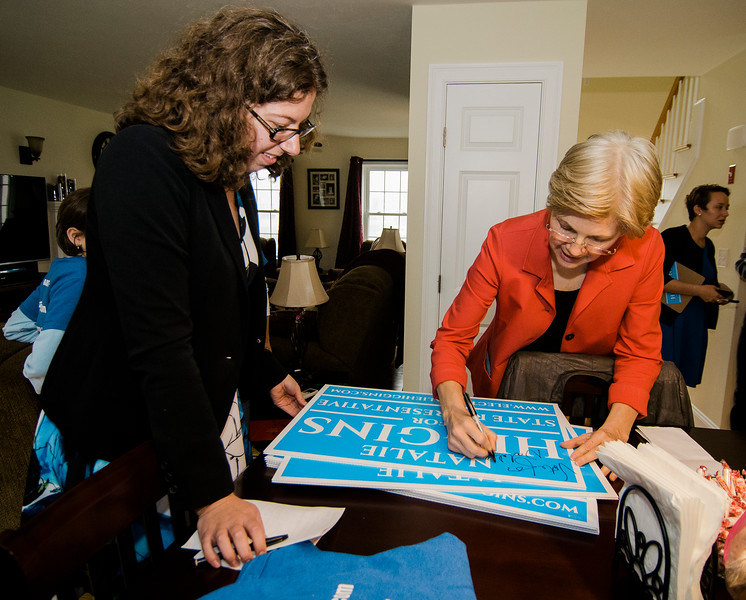 Senator Elizabeth Warren autographs campaign signs for Natalie Higgins during an event at her headquarters on Saturday afternoon. Warren has endorsed Higgins for State Representative in Leominster. SENTINEL & ENTERPRISE / Ashley Green