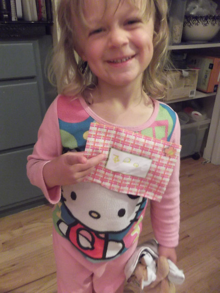 """Izzie wrote a letter to the zoo all by herself. To anyone else, it looks like an envelope (addressed to """"zoo"""") and a bunch of scrap paper inside, but she says it's a letter asking if she can have a zoo pass to come whenever she wants. :-)"""
