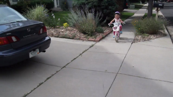 June 2012 - Izzie rides a bike