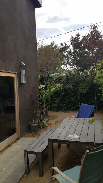 Back patio with dirt floor
