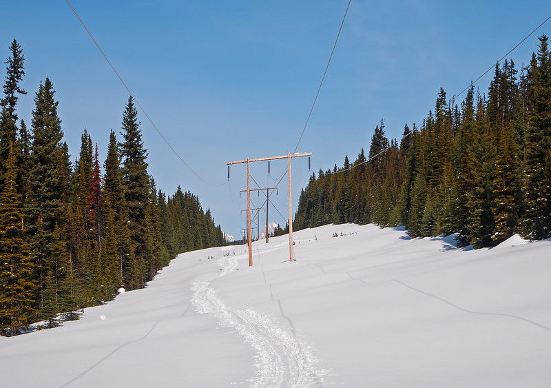A good firm track made by skiers hauling sleds, returning from the Elk Lakes cabin, led easily up to the groomed trail at Elk Pass.