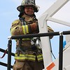 JOHN KLINE | THE GOSHEN NEWS<br /> Steve Kuhns, with the Millersburg-Clinton Fire Territory, smiles as he prepares to begin the Firefighter Challenge at the Elkhart County 4-H Fair grandstand Saturday.