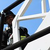 JOHN KLINE | THE GOSHEN NEWS<br /> Robert Pletcher, with the Middlebury Fire Department, gets his game face on as he prepares to begin the Firefighter Challenge at the Elkhart County 4-H Fair grandstand Saturday.