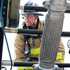 JOHN KLINE | THE GOSHEN NEWS<br /> Kevin Clarke, with the Elkhart City Fire Department, gets his game face on as he prepares to begin the Firefighter Challenge at the Elkhart County 4-H Fair grandstand Saturday.