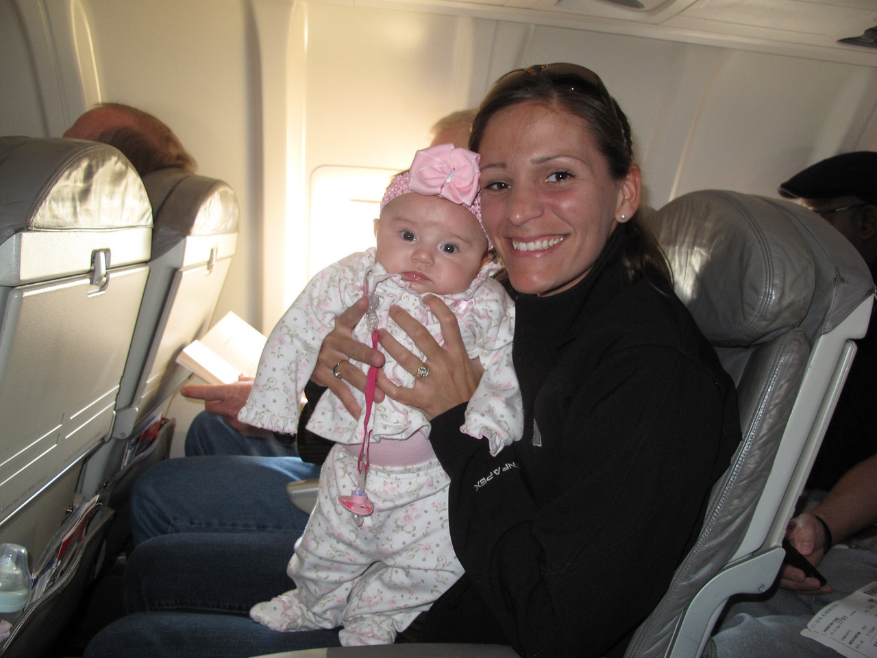 April 2, 2011. Ella's first plane ride. Heading back home to NC.
