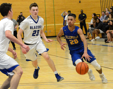 Tania Barricklo-Daily Freeman   Ellenville's Sivon Diconcilio advances the ball up court guarded by Millbrooks's Patrick Kyle.