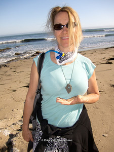 Bev with the pendant I made from a rock and some seaweed.