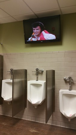 Elvis watches over the urinals