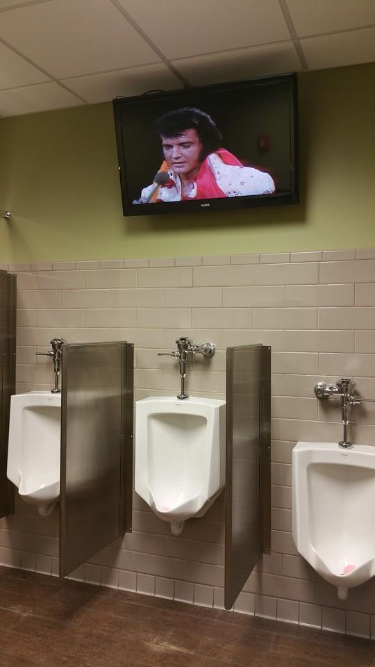 Elvis watches over the urinals