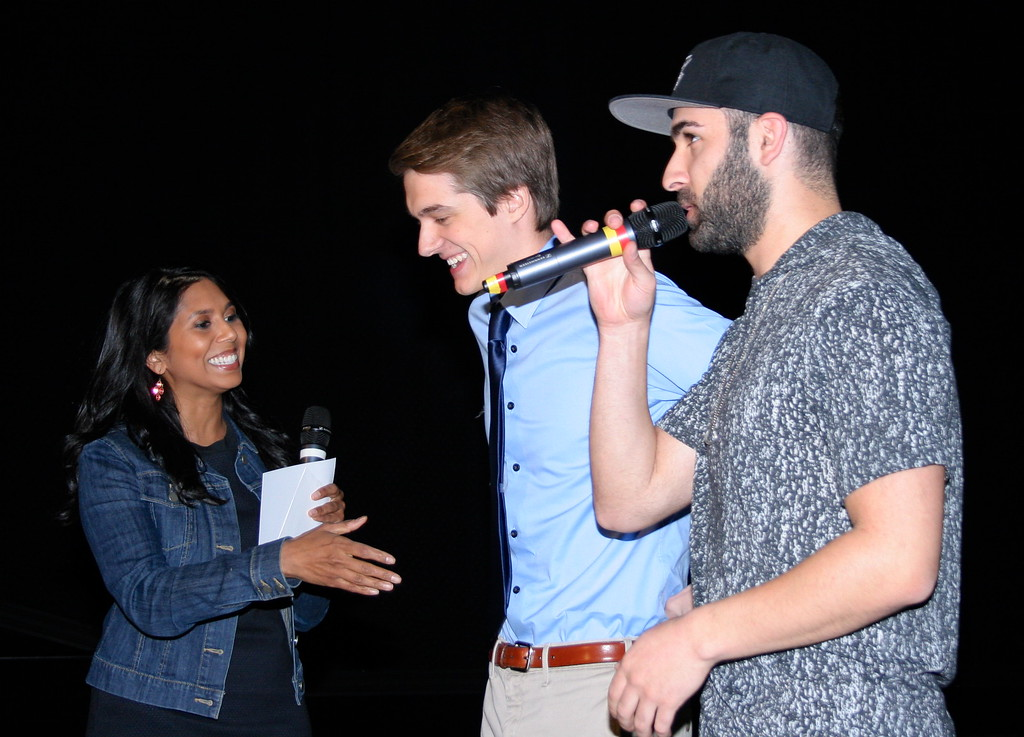 . Local news anchor Anu Prakash (left), congratulates Grand Prize winner Scott McLaren, 18, the film\'s director and a student at Stoney Creek High School, as Channel 955\'s Joey Radio talks with the audience.  Photo by Brandy Baker / For Digital First Media