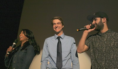 Local news anchor Anu Prakash (left), congratulates Grand Prize winner Scott McLaren, 18, the film's director and a student at Stoney Creek High School, as Channel 955's Joey Radio talks with the audience. Photo by Brandy Baker / For Digital First Media