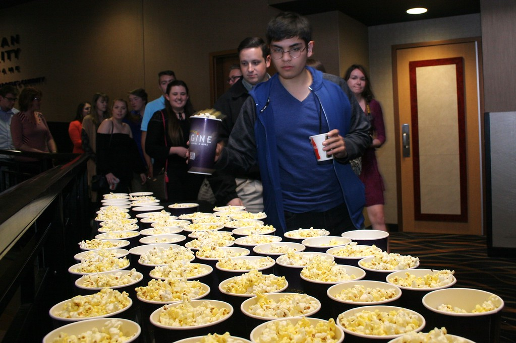 . Guests grab some popcorn on their way into the screening. Photo by Brandy Baker / For Digital First Media