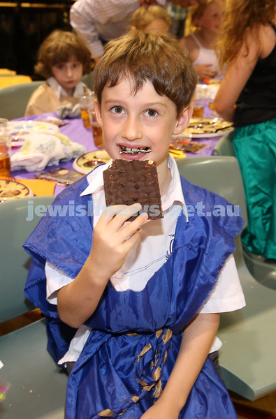 Emanuel infants demo Seder. Sam Salamon enjoying chocolate Matzah.