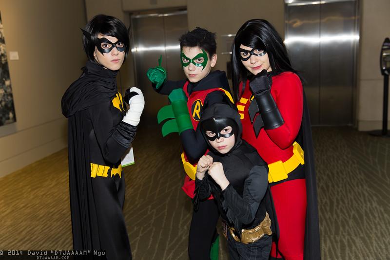 Batgirl, Robins, and Batman