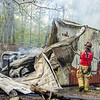 Firefighters work at the scene of a third-alarm barn fire on the 2400 block of Bullfrog Road, Wednesday, April 28, 2021, in Freedom Township. No injuries were reported from the fire, which occurred in a garage that held machinery and vintage trucks.