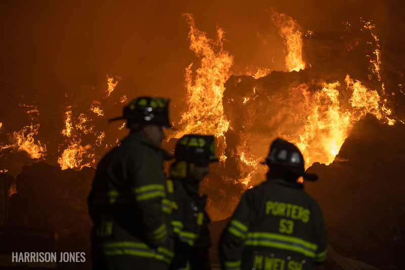 Firefighters work as fire continues to rage through 2,400 large bales of hay hours after a fire broke out inside a 400-foot hay barn along the 6300 block of Old Hanover Road late Saturday evening, as seen in the early hours of Sunday, Nov. 1, 2020, in Heidelberg Township. No one was injured in the fire, according to officials.