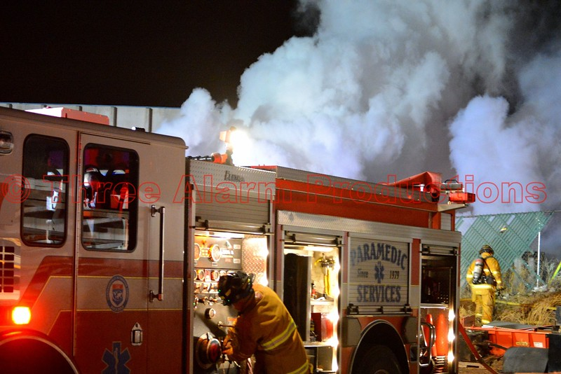 Colorado Springs Engine 7 firefighters working to control a well involved trailer fire, near a commercial building in El Paso County, Colorado. April 9, 2015