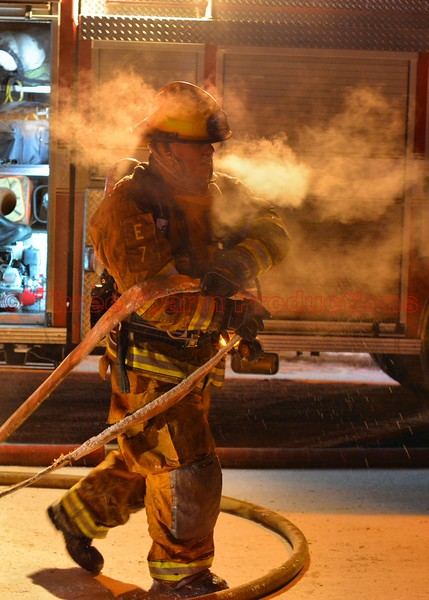 A Colorado Springs Firefighter working in sub-zero temperatures at the scene of a house fire on Colony Hills Circle. December 30, 2014