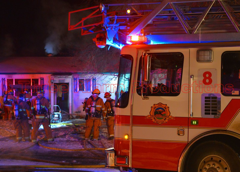 Colorado Springs Firefighters rescue two people and one dog, from a house fire on Colony Hills Circle. December 30, 2014