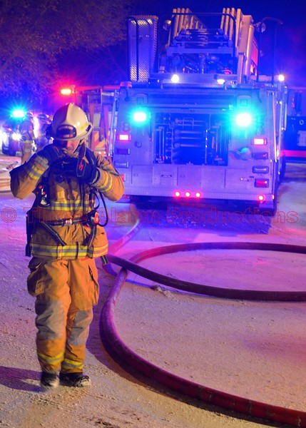 A Colorado Springs District Chief on the fireground of a two-alarm residential structure fire. December 30, 2014